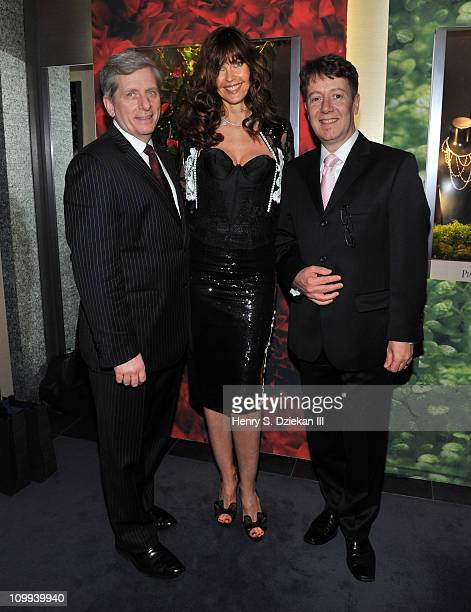 President of Piaget NA Larry Boland model Carol Alt and botique manager Laercio Xavier attend a gaarden party at the Piaget Boutique on March 10 2011...
