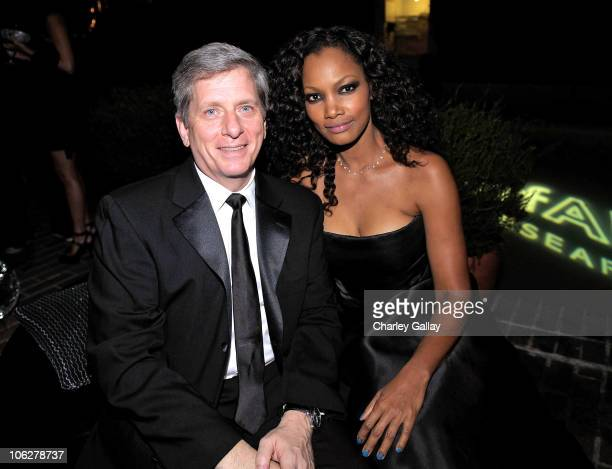 President of Piaget North America Larry Boland and actress Garcelle Beauvais attend the amfAR Inspiration Gala LA sponsored by Piaget at the Chateau...