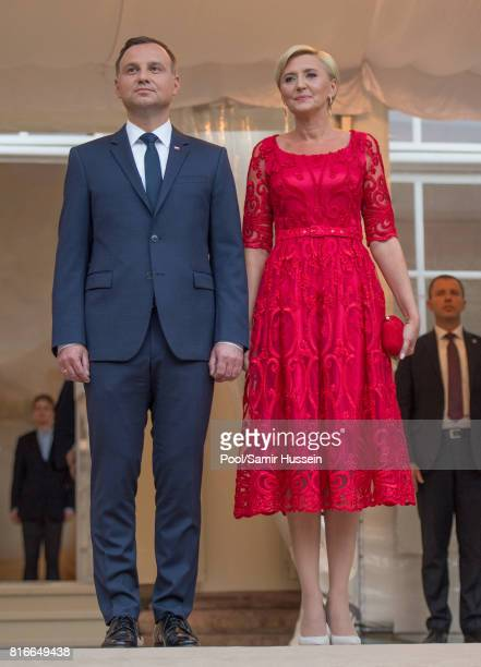 President of Poland Andrzej Duda and the first Lady Agata KornhauserDuda attend the Queen's Birthday Garden Party at the Orangeryeduring an official...