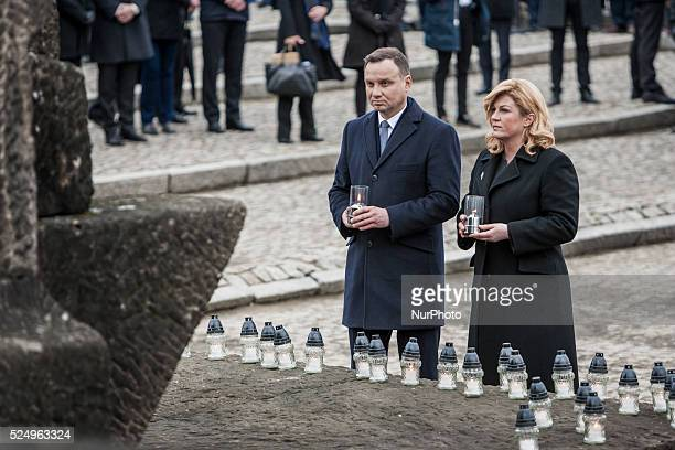 President of Poland Andrzej Duda and the president of Croatia Kolinda GrabarKitarovic lay candles in front of the Monument to the Victims in Birkenau...