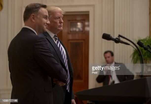 President of Poland Andrzej Duda and US President Donald Trump shake hands at a Joint Press Conference in the East Room in the White House on...