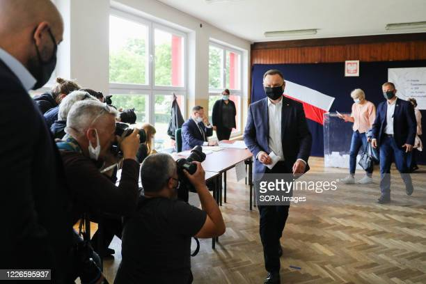 President of Poland Andrzej Duda seen at the polling station before casting his vote The incumbent President of Poland Andrzej Duda with Poland's...