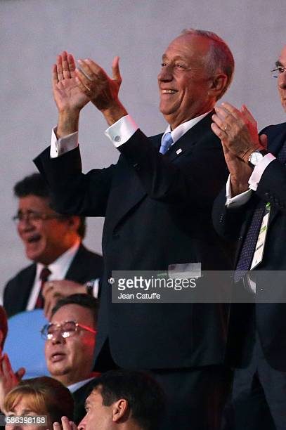 President of Portugal Marcelo Rebelo de Sousa applauds his delegation during the opening ceremony of the 2016 Summer Olympics at Maracana Stadium on...