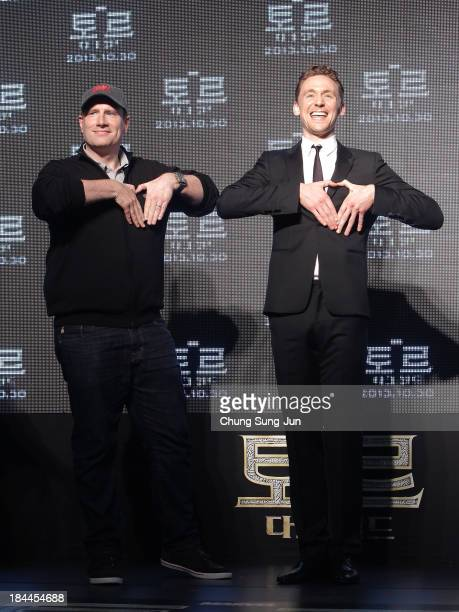 President of Production at Marvel Studios Kevin Feige and actor Tom Hiddleston attend the 'Thor The Dark World' premiere at Time Square on October 14...