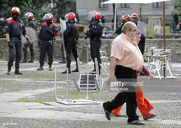 President of proindependence party Basque Nationalist ActionANV Kepa Bereziartua walks away after Basque police charged against an illegal political...