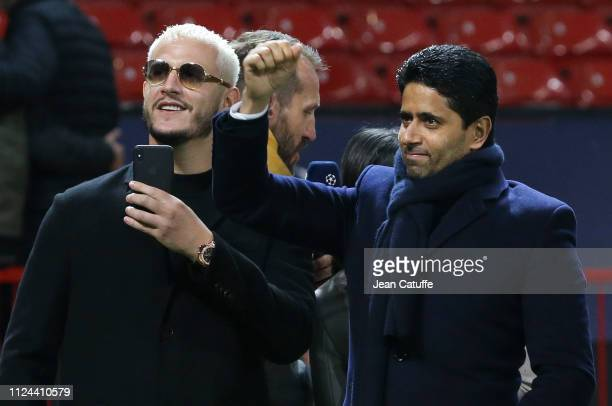 President of PSG Nasser Al Khelaifi DJ Snake celebrate the victory following the UEFA Champions League Round of 16 First Leg match between Manchester...