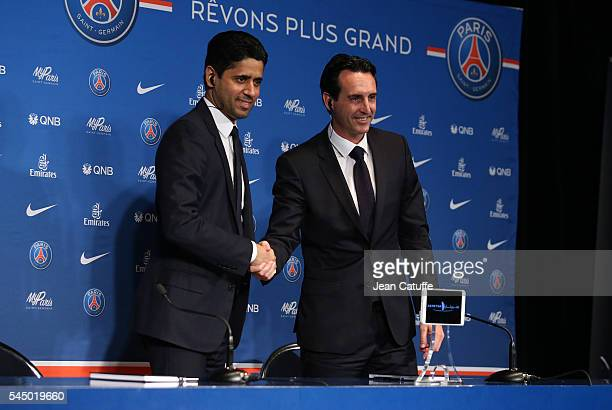 President of PSG Nasser AlKhelaifi introduces Unai Emery of Spain as the new coach of Paris SaintGermain during a press conference at Parc des...