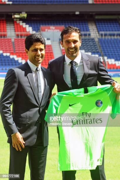 President of PSG Nasser AlKhelaifi presents to Gianluiggi Buffon his new jersey during the Italian official presentation after signing for PSG at...
