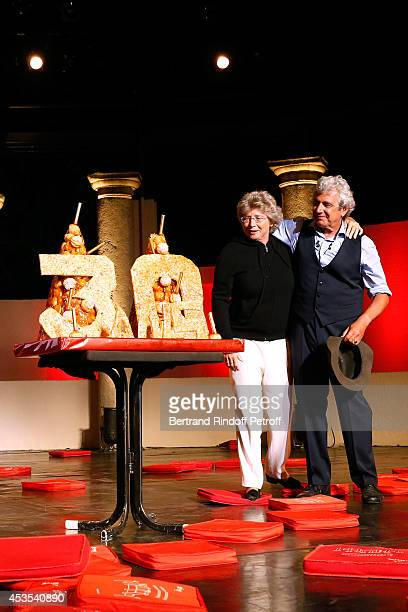 President of Ramatuelle Festival Jacqueline Franjou and Artistic Director of the Festival Michel Boujenah pose near a Birthday Cake for the 30th...