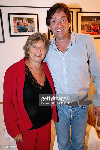 President of Ramatuelle Festival Jacqueline Franjou and Autor of the play and actor Pierre Palmade pose backstage after Le fils du comique play at...