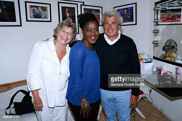 President of Ramatuelle Festival Jacqueline Franjou humorist Gloria Tagbo and Artistic Director of the Festival Michel Boujenah pose backstage after...