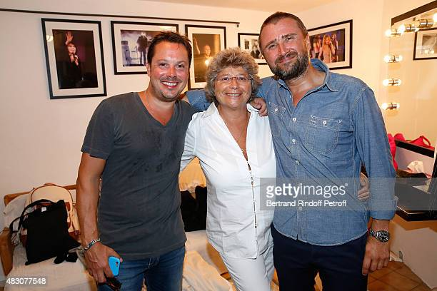 President of Ramatuelle Festival Jacqueline Franjou standing between Actors of the Piece Alexandre Brasseur and Davy Sardou pose Backstage after the...