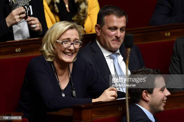 President of Rassemblement National Marine Le Pen laughs as ministers answer deputies during the weekly session of questions to the government at...