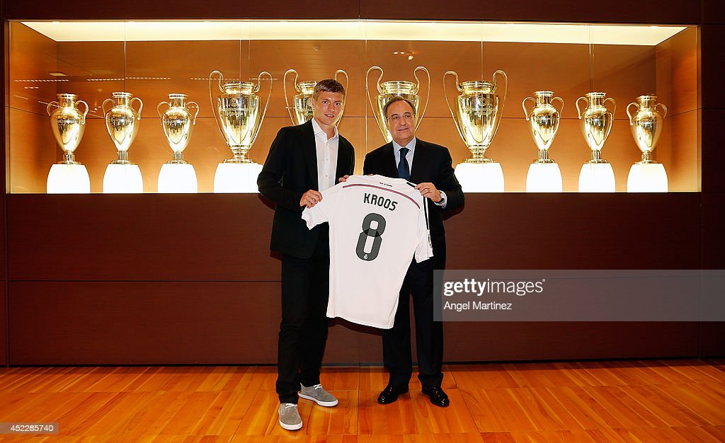 President of Real Madrid Florentino Perez (R) pose with Toni Kroos during his official unveiling as a new Real Madrid player at Estadio Santiago Bernabeu on July 17, 2014 in Madrid, Spain.