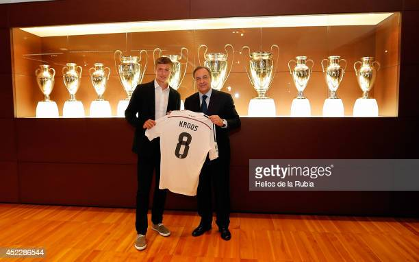 President of Real Madrid Florentino Perez pose with Toni Kroos during his official unveiling as a new Real Madrid player at Estadio Santiago Bernabeu...