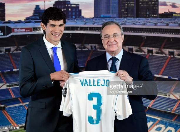 President of Real Madrid Florentino Perez poses with the club's new player Jesus Vallejo at the Santiago Bernabeu stadium in Madrid, on July 7, 2017....