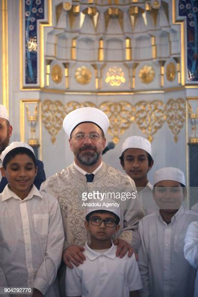 President of Religious Affairs of Turkey Ali Erbas poses for a photo with children after performing Friday Prayer at the Diyanet Center of America...