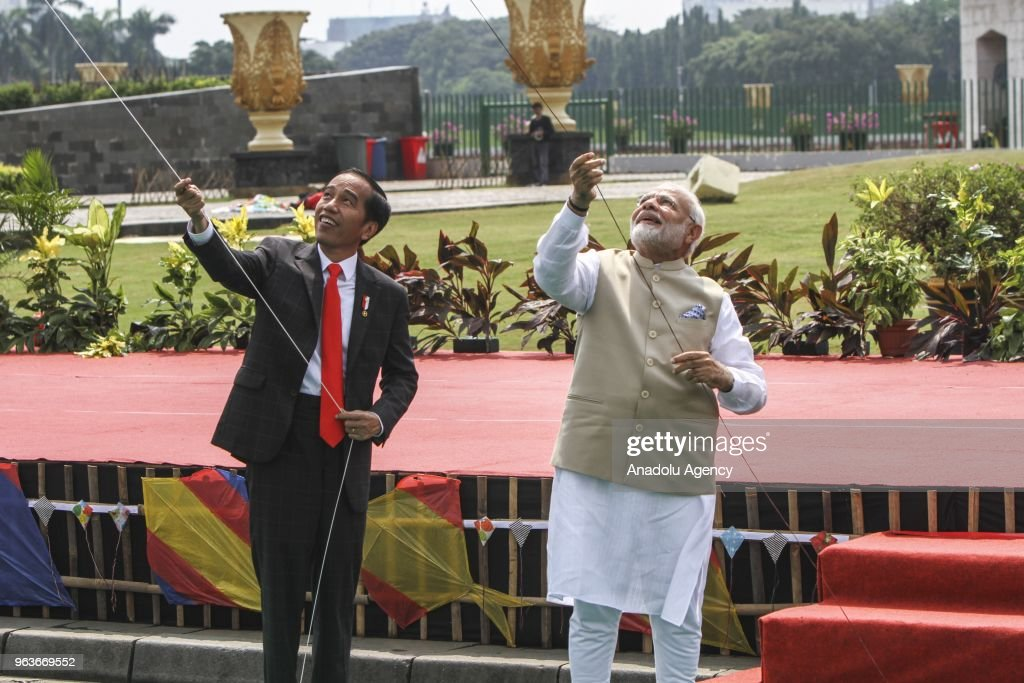 President of Republic Indonesia Joko Widodo (L) and Indian Prime Minister Narendra Modi (R) fly kites at the cross field of National Monument (Monas) Jakarta, Indonesia on Wednesday, May 30, 2018. The two heads of government were playing kites in ' Indonesia - India Kite Exhibition, which was held to commemorate 70 years of bilateral relations between Indonesia and India.