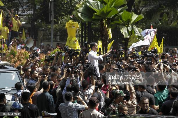 President of Republic of Indonesia Joko Widodo waves his hand after he and Maruf Amin register their candidacy at the General Elections Commission...