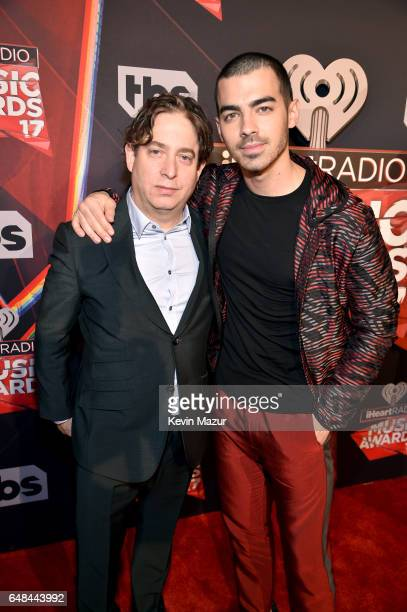 President of Republic Records Group Charlie Walk and Singersongwriter Joe Jonas attend the 2017 iHeartRadio Music Awards which broadcast live on...