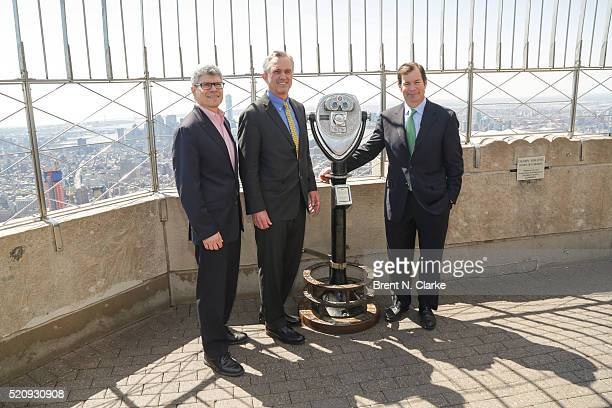 President of Riverkeeper Paul Gallay attorney Robert F Kennedy Jr and retired New York Rangers hockey player Mike Richter pose for photographs after...