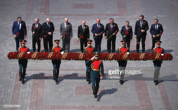 President of Russia and Commander-in-Chief of the Armed Forces Vladimir Putin and heads of state invited for the military parade take part in the...