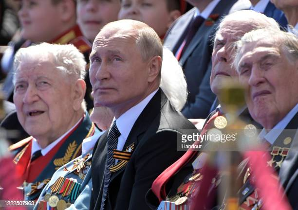 President of Russia and Commander-in-Chief of the Armed Forces Vladimir Putin watches a Victory Day military parade marking the 75th anniversary of...