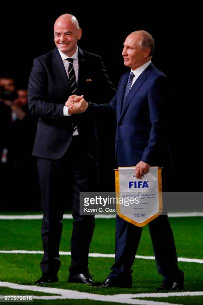 President of Russia Vladimir Putin and FIFA President Gianni Infantino shake hands during the 68th FIFA Congress at the Moscow Expocentre on June 13...