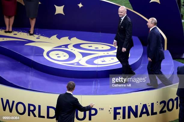 President of Russia Vladimir Putin and FIFA president Gianni Infantino walk onto the podium prior to the trophy presentation following the 2018 FIFA...
