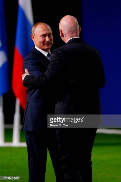 President of Russia Vladimir Putin is greeted by FIFA President Gianni Infantino during the 68th FIFA Congress at the Moscow Expocentre on June 13...