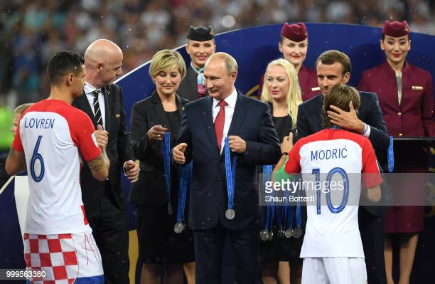 President of Russia Vladimir Putin presents Dejan Lovren and Luka Modric of Croatia with their medals next to FIFA president Gianni Infantino and...