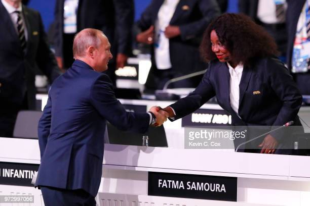 President of Russia Vladimir Putin shakes hands with FIFA Secretary General Fatma Samoura during the 68th FIFA Congress at the Moscow Expocentre on...