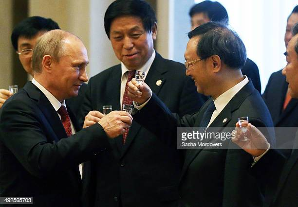 President of Russia Vladimir Putin toasts with vodka along with Chinese delegates during a signing ceremony on May 21 2014 in Shanghai China Russia...
