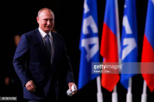 President of Russia Vladimir Putin walks to the stage during the 68th FIFA Congress at the Moscow Expocentre on June 13 2018 in Moscow Russia