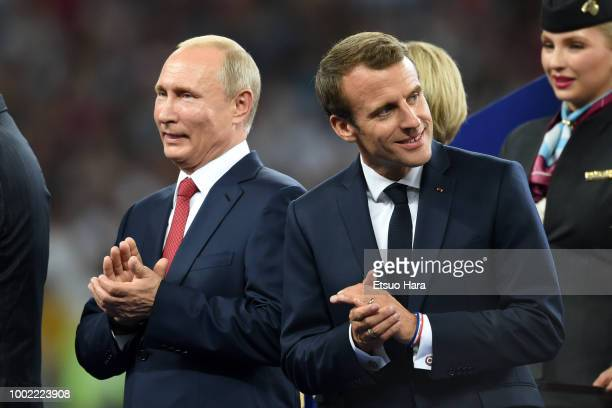 President of Russia Vladimir Putinand President of France Emmanuel Macron are seen during the trophy ceremony following the 2018 FIFA World Cup...