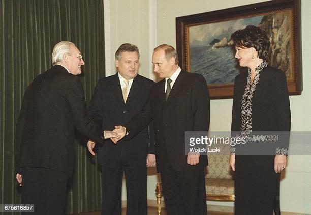 President of Russia Vladimir Putin's visit to Poland. Pictured Polish film director Andrzej Wajda, Polish President Aleksander Kwasniewski, Vladimir...