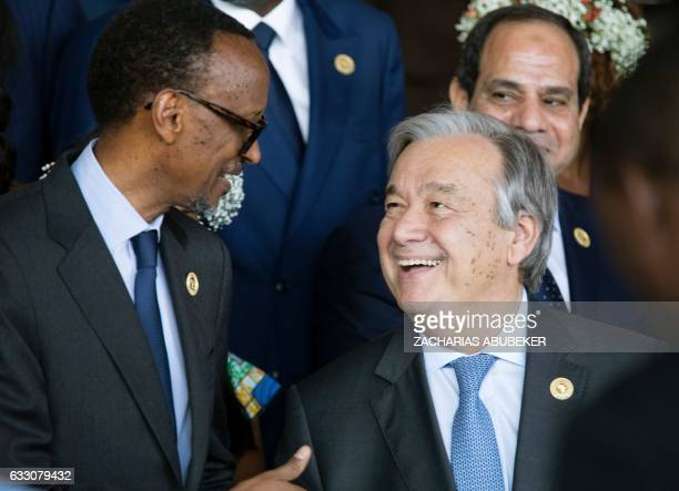 President of Rwanda Paul Kagame speaks with Secretary General of the United Nations Antonio Guterres as they gather for the family photograph during...