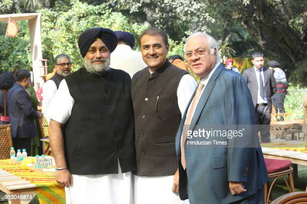 President of Shiromani Akali Dal Sukhbir Singh Badal NCP leader Praful Patel and Lawyer Raian Karanjawala during annual Basant lunch at the residence...