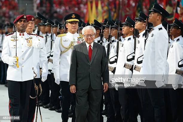 President of Singapore Tony Tan Keng Yam inspects the guard of honour contingent during the National Day Parade at Padang on August 9 2015 in...