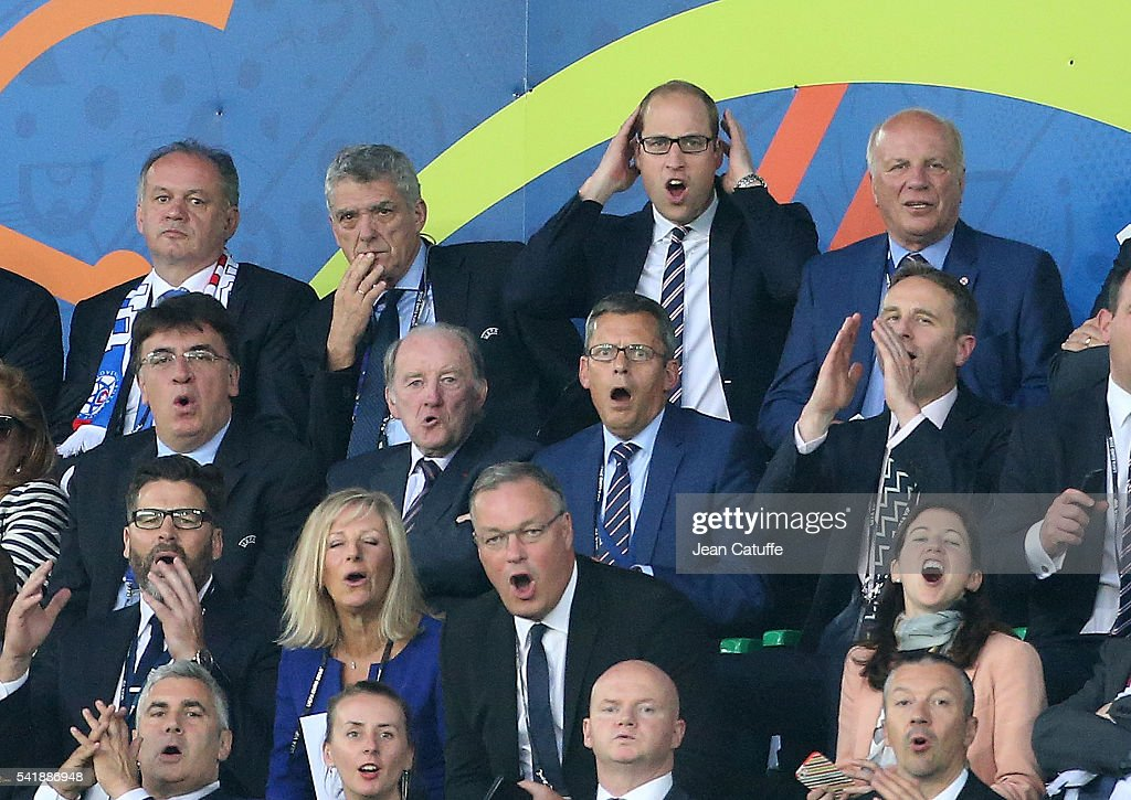 President of Slovakia Andrej Kiska (far left with the scarf) ,Prince William, Duke of Cambridge and the FA chairman Greg Dyke (right) react during the UEFA EURO 2016 Group B match between Slovakia and England at Stade Geoffroy-Guichard on June 20, 2016 in Saint-Etienne, France.