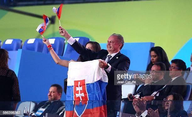 President of Slovakia Andrej Kiska waves to the slovakian delegation during the opening ceremony of the 2016 Summer Olympics at Maracana Stadium on...