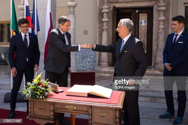 President of Slovenia Borut Pahor and President of Portugal Marcelo Rebelo de Sousa fist-bump after signing the citys book of honor during the...