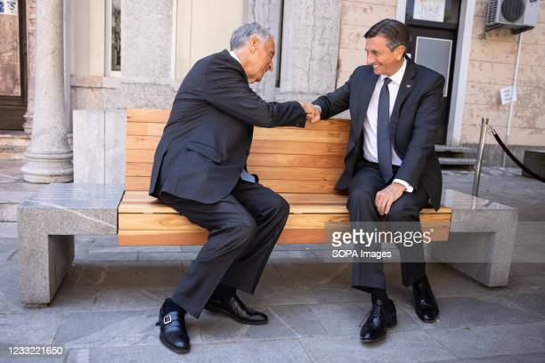 President of Slovenia Borut Pahor and President of Portugal Marcelo Rebelo de Sousa fist-bump as they sit on a bench of friendship between the...