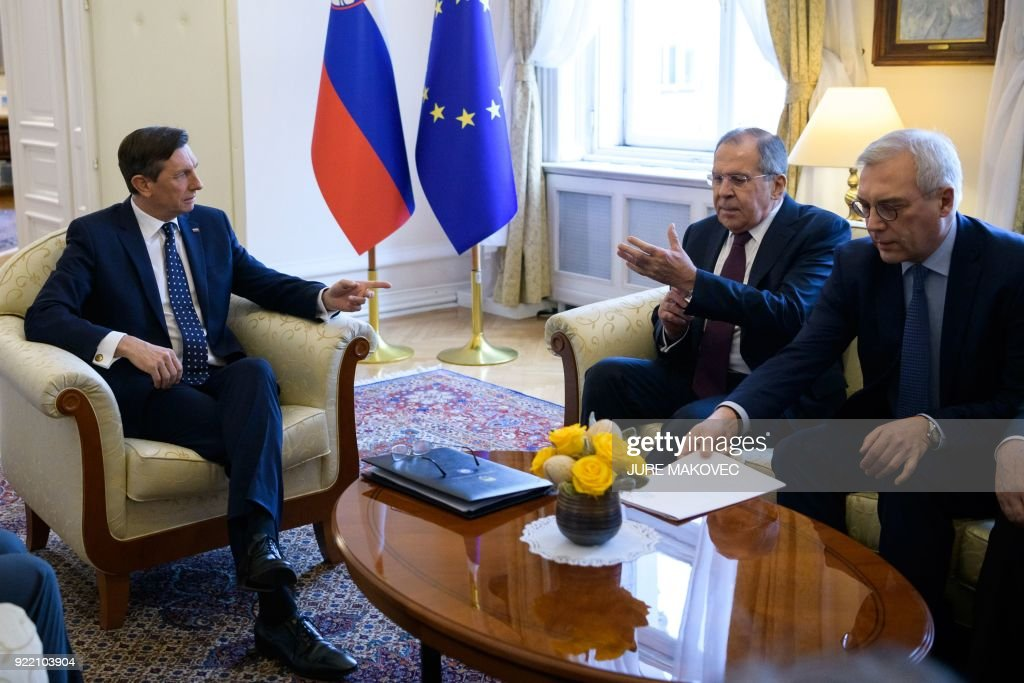 President of Slovenia Borut Pahor (L) meets with Russian Foreign Minister Sergei Lavrov (C) in Ljubljana on February 21, 2018. / AFP PHOTO / Jure Makovec
