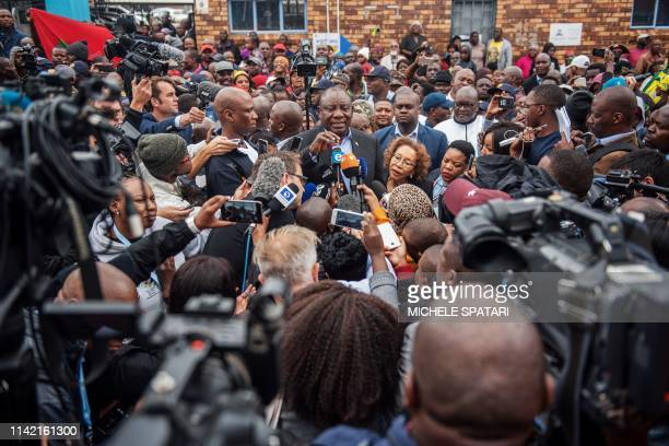 President of South Africa and the African National Congress Cyril Ramaphosa speaks with the press after casting his vote for the general elections at...