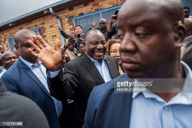 President of South Africa and the African National Congress Cyril Ramaphosa waves as he arrives to cast his vote for the general elections at the...