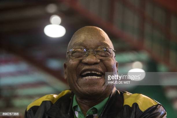 President of South Africa Jacob Zuma smiles during the last day of the NASREC Expo Centre in Johannesburg on December 20 during the African National...