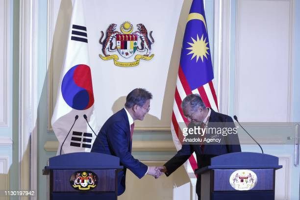 President of South Korea Moon Jaein and Prime Minister of Malaysia Mahathir Mohamad shake hands during a joint press conference in Putrajaya Malaysia...