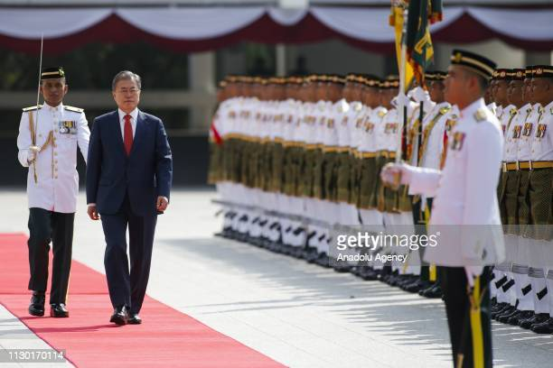 President of South Korea Moon Jaein inspects a ceremonial guard of honour during a welcoming ceremony at the Parliament in Kuala Lumpur on March 13...