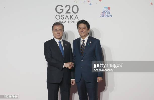 President of South Korea Moon Jaein is welcomed by Japanese Prime Minister Shinzo Abe on the first day of the G20 summit in Osaka Japan on June 28...